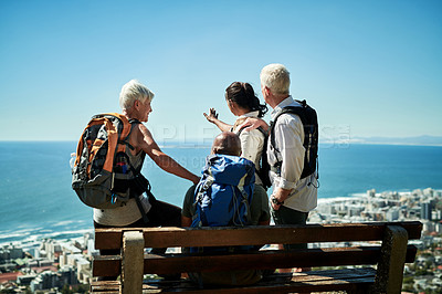Buy stock photo Rearview shot of a group of senior people looking at the view while hiking together outdoors