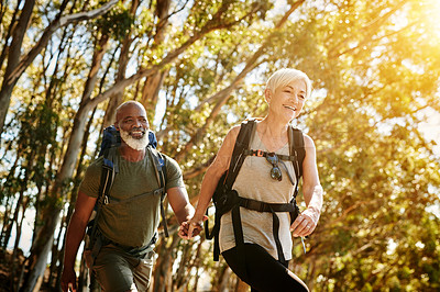 Buy stock photo Shot of a senior couple hiking together out in the mountains