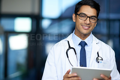 Buy stock photo Portrait of a young doctor using a digital tablet in a hospital