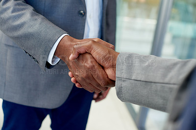 Buy stock photo Shot of unrecognizable businesspeople shaking hands in agreement at work