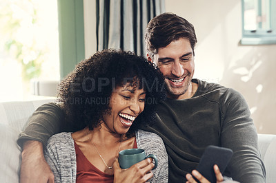 Buy stock photo Shot of an affectionate couple spending some quality time together in their living room at home