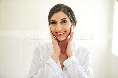 Buy stock photo Cropped shot of a beautiful young woman touching her face
