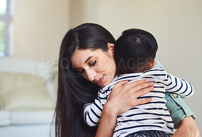 Buy stock photo Cropped shot of a young woman spending quality time with her son at home