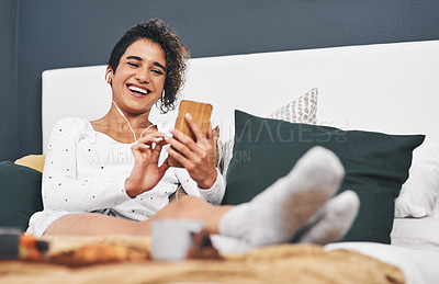 Buy stock photo Shot of an attractive young woman enjoying a luxurious breakfast in her room
