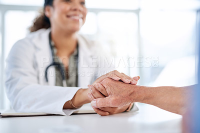 Buy stock photo Shot of an unrecognizable female doctor holding hands and comforting a senior man at a hospital
