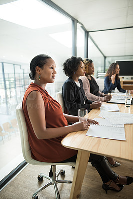 Buy stock photo Shot of a group of businesswomen having a meeting in a modern office