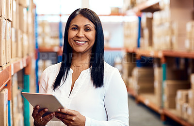 Buy stock photo Portrait of a mature factory manager using a digital tablet in a warehouse