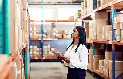 Buy stock photo Shot of a mature factory manager using a digital tablet in a warehouse
