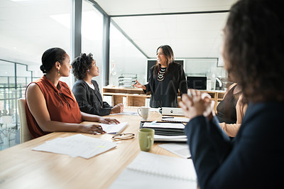 Buy stock photo Shot of a group of young businesswomen having a meeting in the boardroom