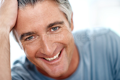 Buy stock photo Headshot portrait of a handsome mature man smiling while looking at the camera during the day