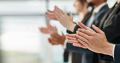 Buy stock photo Cropped shot of a group of unrecognizable businesspeople clapping while standing in a row in an office