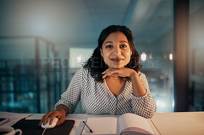 Buy stock photo Portrait of a beautiful young businesswoman working late in her office during the night