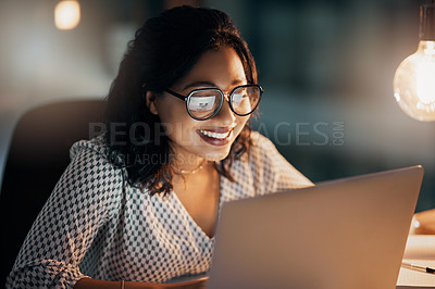 Buy stock photo Shot of beautiful young businesswoman feeling cheerful while working late in her office at work