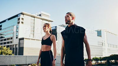 Buy stock photo Shot of a young couple going for a workout together in the city