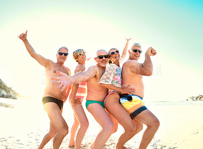 Buy stock photo Cropped portrait of a group of senior friends being playful together while out at the beach
