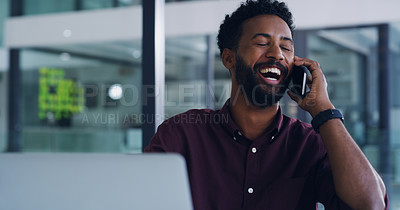 Buy stock photo Shot of a handsome young businessman making a phone call in his office at work