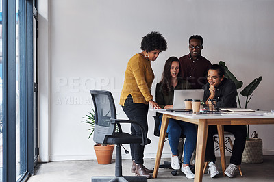 Buy stock photo Full length shot of a diverse group of businesspeople working on a laptop together in a modern office