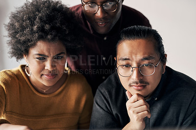 Buy stock photo Cropped shot of a group of young businesspeople sitting and working together in the office during the day