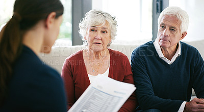 Buy stock photo Shot of a senior couple meeting with a consultant to discuss paperwork at home
