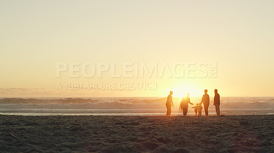 Buy stock photo Full length shot of a senior group of friends enjoying a day on the beach with their grandchildren at sunset