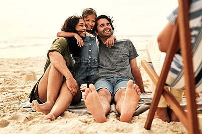 Buy stock photo Full length shot of a beautiful young family of three spending the day together at the beach
