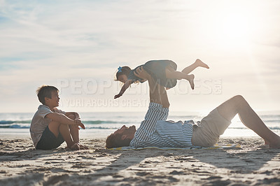 Buy stock photo Cropped shot of an affectionate mature father bonding with his two children during a day on the beach together