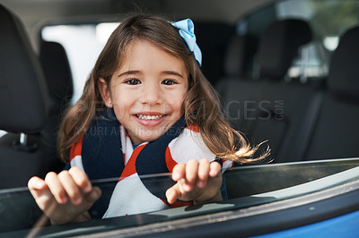 Buy stock photo Cropped portrait of a young girl sitting in the car before going on a roadtrip with her family