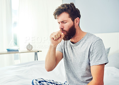 Buy stock photo Cropped shot of a young man coughing at home