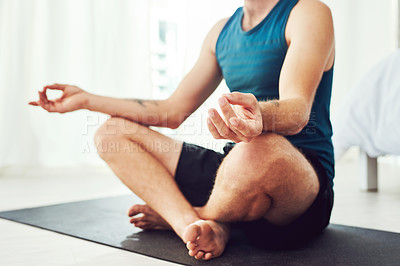Buy stock photo Cropped shot of an unrecognizable man practising yoga in his bedroom