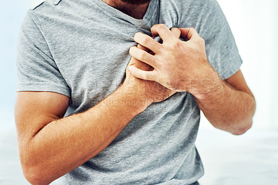 Buy stock photo Cropped shot of an unrecognizable man suffering from chest pain