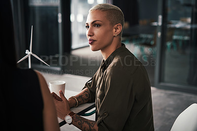 Buy stock photo Shot of an attractive young businesswoman paying attention during a meeting with colleagues at work