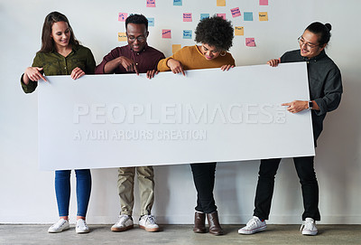 Buy stock photo Full length shot of a group of of young businesspeople holding a placard together at work