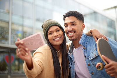Buy stock photo Shot of a happy young couple taking a selfie with a smartphone at university