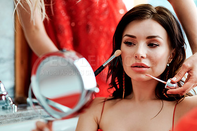 Buy stock photo Shot of hands applying makeup with brushes to a glamorous young woman