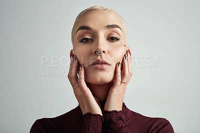 Buy stock photo Portrait of an attractive and stylish young woman posing against a grey background