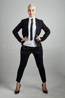 Buy stock photo Full length shot of an attractive young businesswoman posing against a grey background