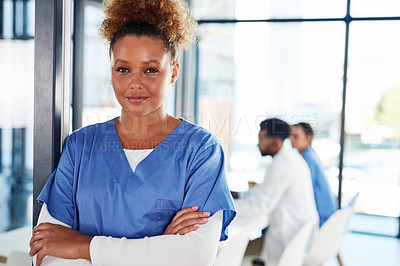 Buy stock photo Portrait of a young medical practitioner standing in a hospital