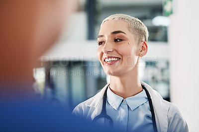 Buy stock photo Shot of a young doctor having a discussion with her colleagues in a hospital