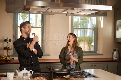 Buy stock photo Cropped shot of an affectionate couple standing together in the kitchen at home