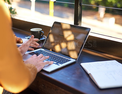 Buy stock photo Closeup shot of an unrecognizable businessman using his laptop while relaxing at an outdoor cafe
