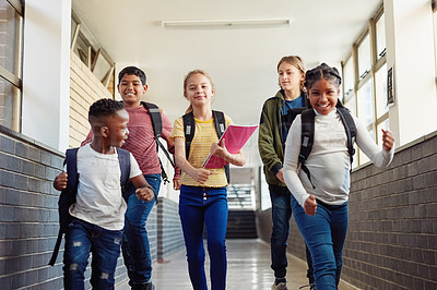 Buy stock photo Shot of a group of children walking through the hall of a school
