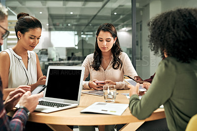 Buy stock photo Cropped shot of a diverse group of businesspeople sitting in the office together and working with technology and documents