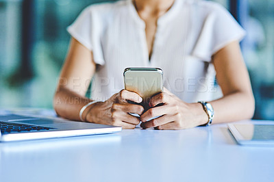 Buy stock photo Closeup shot of an unrecognisable woman using a cellphone in an office