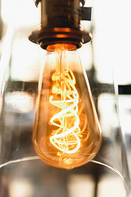 Buy stock photo Still life shot of a powered on light bulb indoors