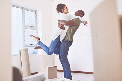 Buy stock photo Shot of a happy young couple moving into their new home