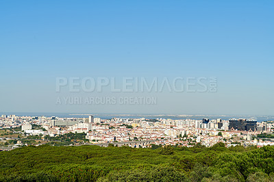 Buy stock photo Landscape shot of the city of Portugal surrounded by the sea and plant-life during the day