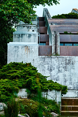 Buy stock photo Cropped shot of a neglected building exterior surrounded by greenery in Portugal