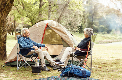 Buy stock photo Shot of a senior couple camping together in the wilderness