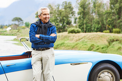 Buy stock photo Cropped shot of a senior man out on a road trip on a sunny day