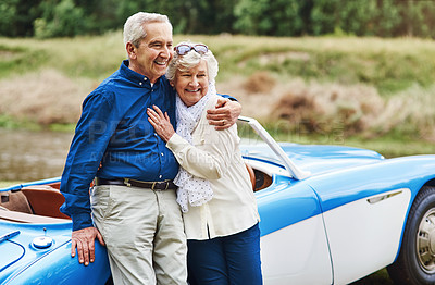 Buy stock photo Rearview shot of a senior couple stopping to enjoy the view while out on a road trip